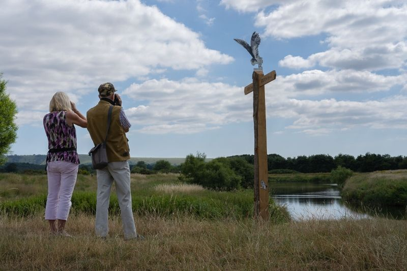 Man and woman looking out over Pulborough Brooks
