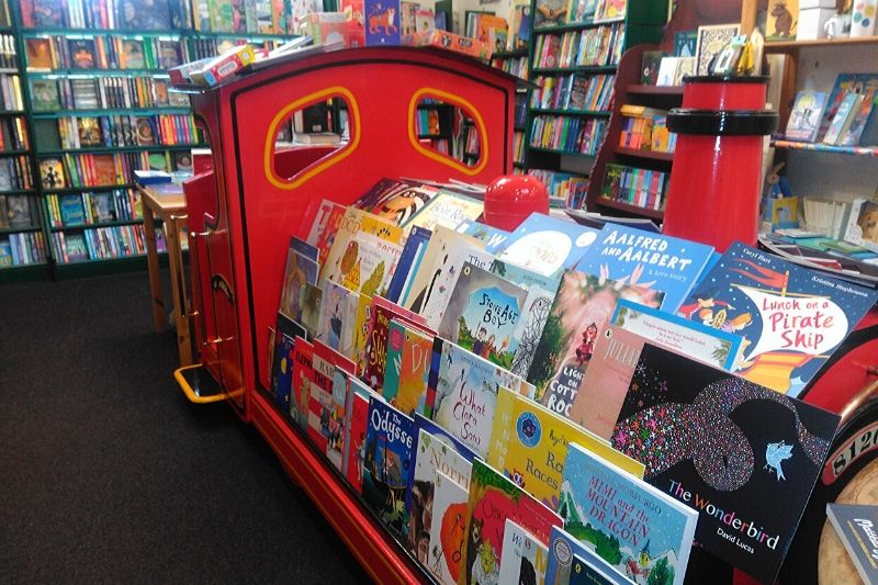 A red train filled with books in the Steyning Bookshop