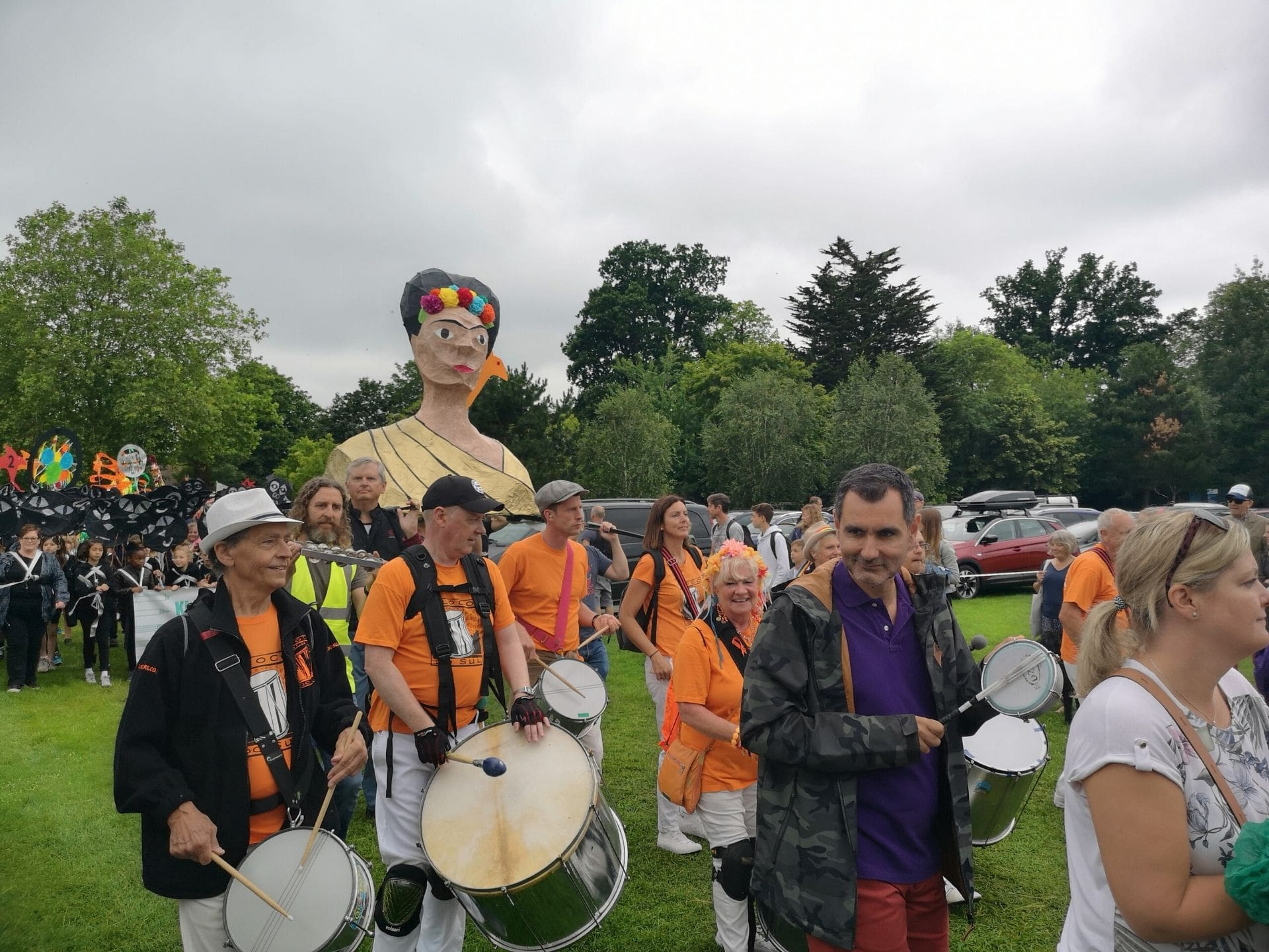 A parade of drummers in Horsham Park