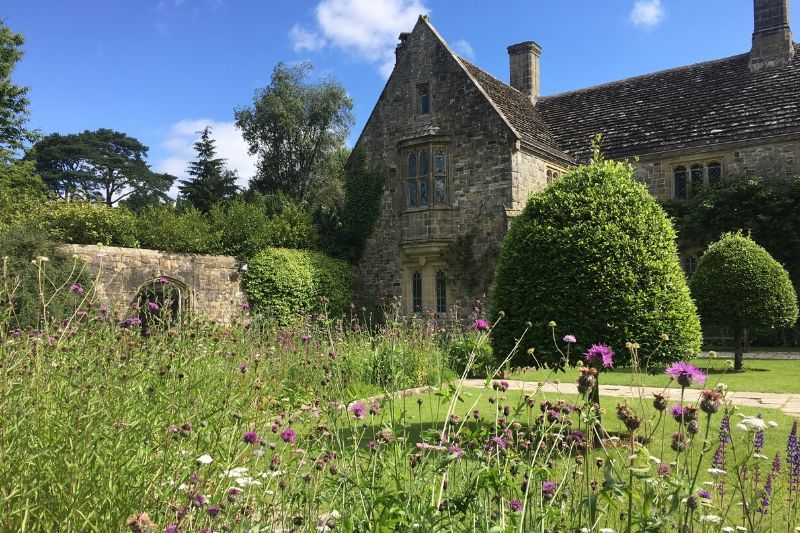 A view of Nymans Gardens and the charming house and gallery