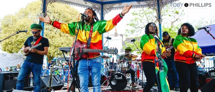 Caribbean Festival band playing and signing on Horsham's bandstand