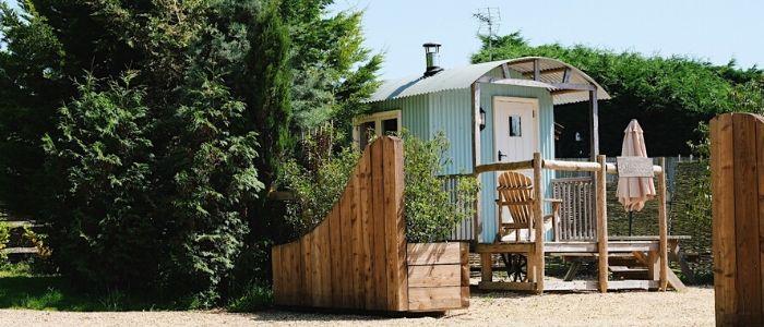 A pale blue shepherd's hut in Sumners Ponds
