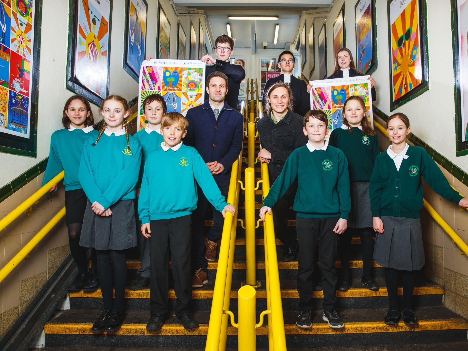 Children in school uniform at Horsham station with their artwork