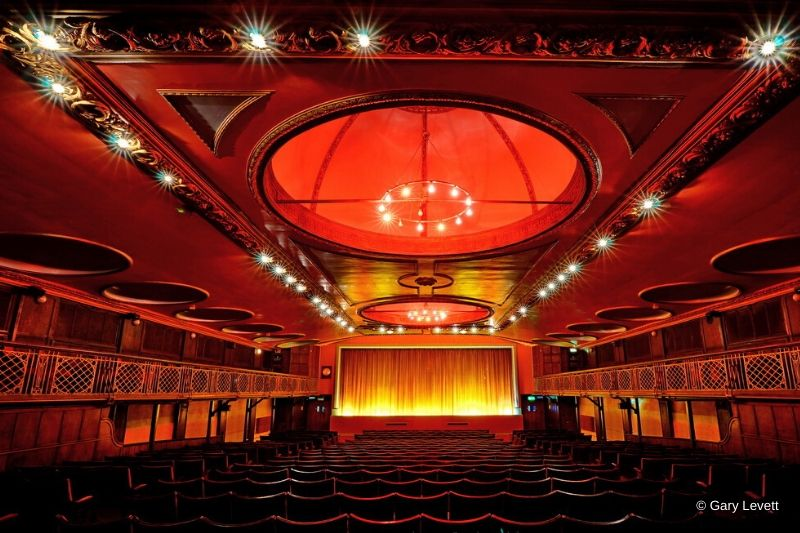 Red seats and classic lighting give the theatre a timeless feel