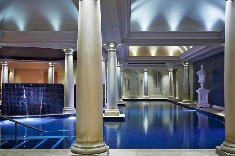 The swimming pool at Alexander House has Grecian-style columns