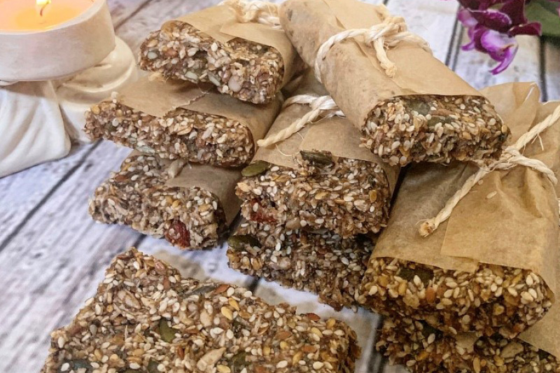 Raw cinnamon seed bars wrapped in paper