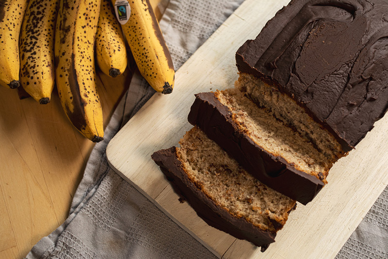 Vegan banana bread with chocolate icing by Cocoa Loco