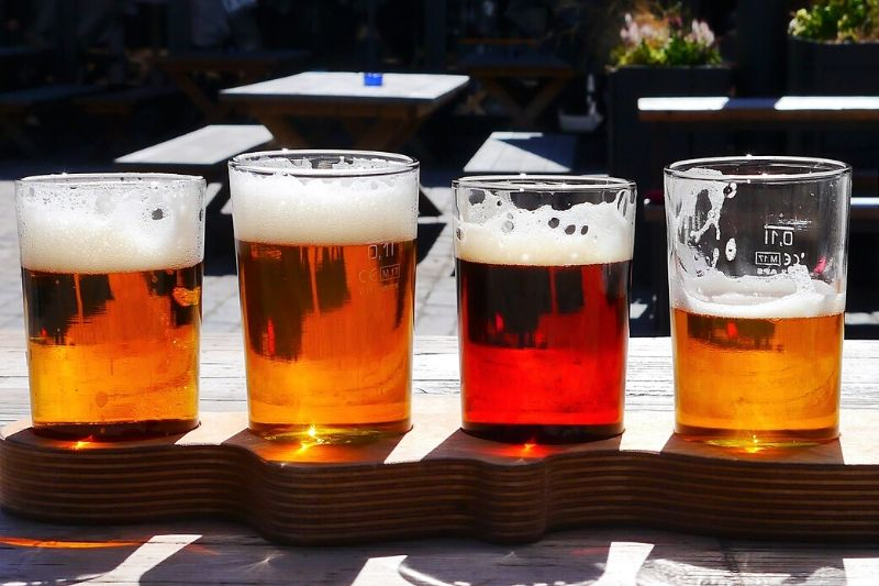 Four pints of beer in a row