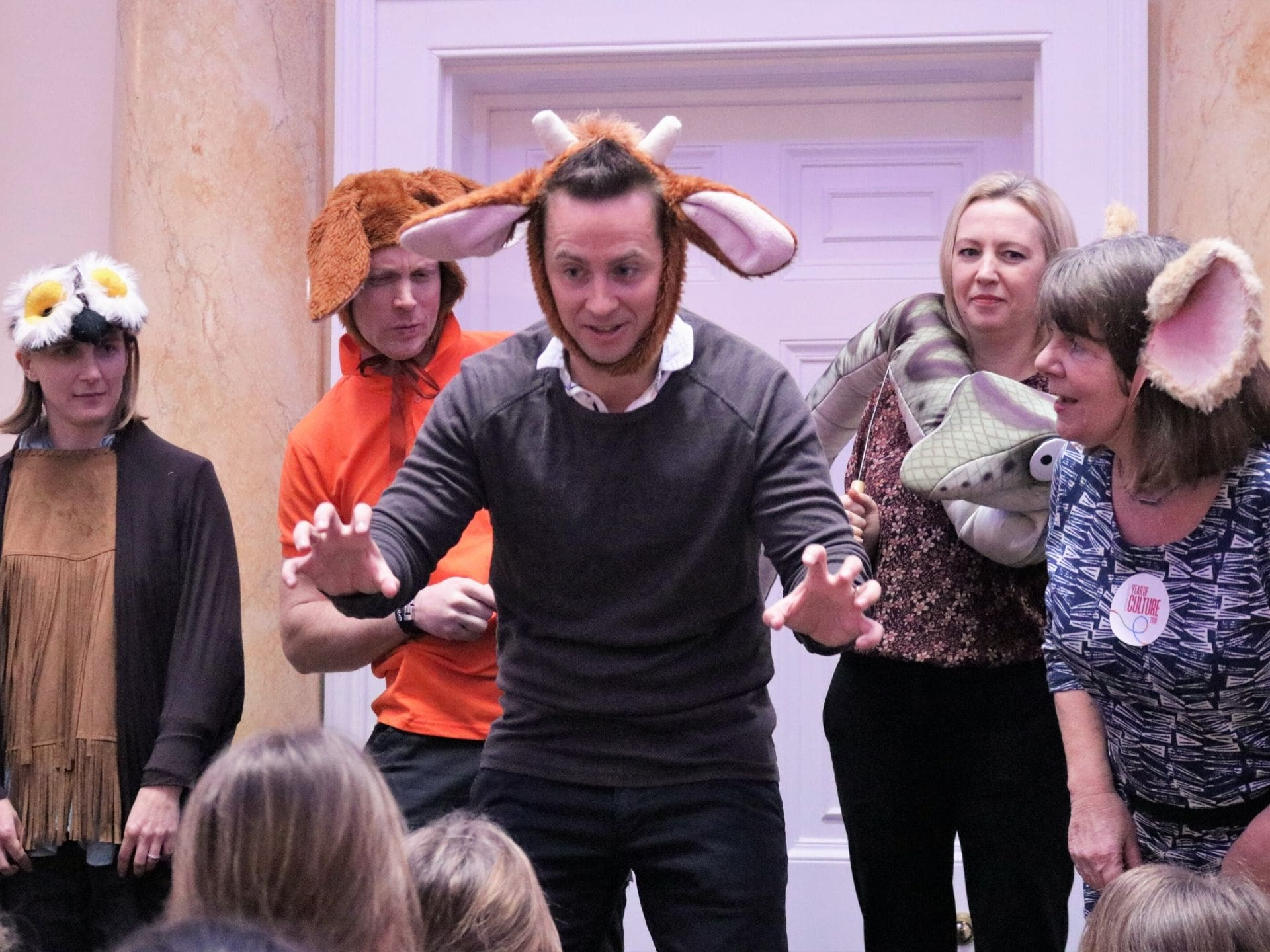 Actors dressed as animals entertain children
